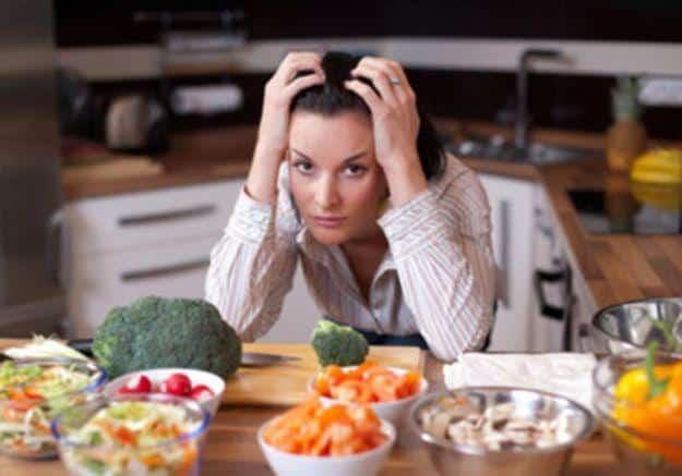 mujer con problemas de alimentación
